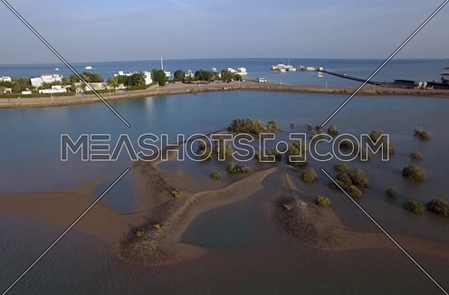 Drone shot flying above lagoon at Day