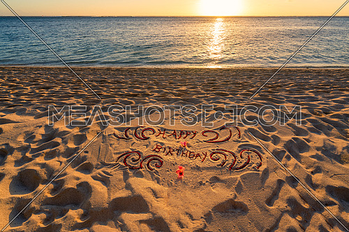 Handwritten on the sand