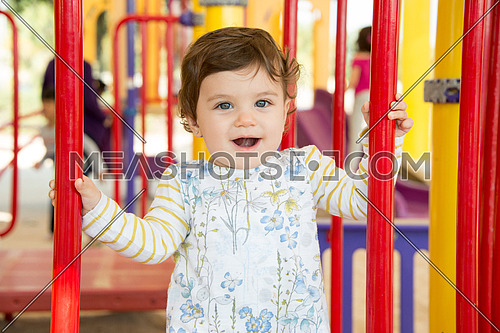 a happy beautiful baby girl in the park