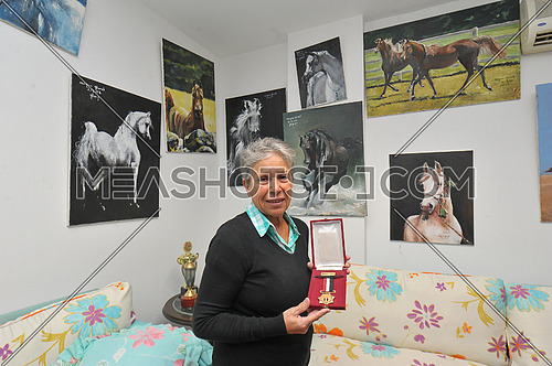 Najwa Gharab is a 75-year-old Egyptian swimmer who joined the team of pioneers at the Heliopolis Club in 2010. She has played many international competitions with the team and competed in the world's top swimmers. In 2010 she won two silver medals at the Canada Rood World Championship over 60 years, Swimming in America, for those aged 70 to 74 years, in the 50 meters, and won the fifth place in the 100 meters.this photos taken at her home in rehab city new cairo at 8 february 2018