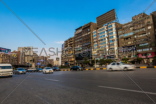 Long shot for traffic in Gamet Al Dowal Street at Cairo at Day