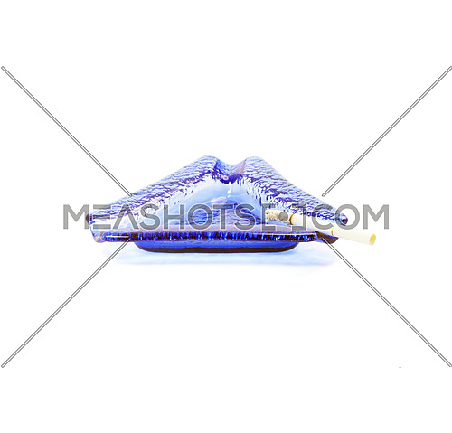 blue murano glass ashtray with lighted cigarette isolated on white background