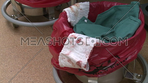 Pan Right medium shot for used surgical rags with blood stains
