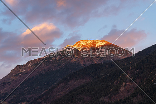 Beautiful panorama of the snow-covered Orobie mountains of the Seriana Valley and the Sedornia Valley at sunset.