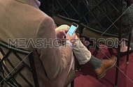 A man typing on his smart phone