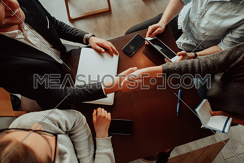 Business people or lawyers shaking hands finishing up meeting or negotiation in sunny office. Business handshake and partnership
