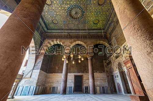 Ornate ceiling with blue and golden floral pattern decorations framed by two columns at Sultan Barquq mosque, Al Moez Street, Old Cairo, Egypt