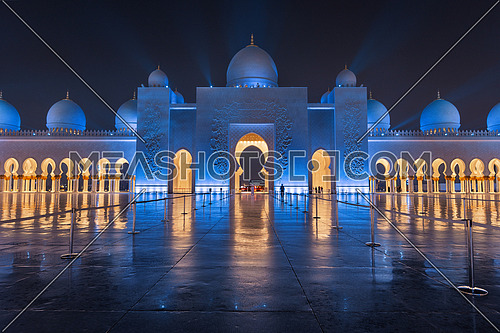 Sheikh Zayed Grand Mosque at Night Covered with Beautiful Blue Lights and light rays