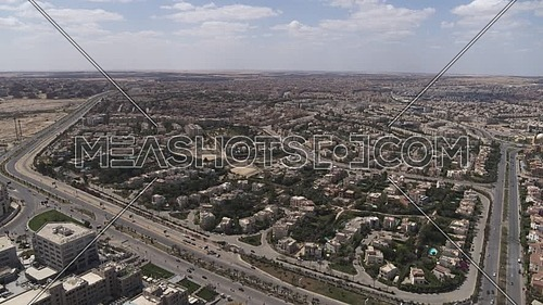 Aerial shot flying over Sheikh Zayed City empty streets during the corona pandemic lockdown by day 10 April 2020