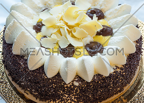 In the picture a chocolate cake with cream view from above