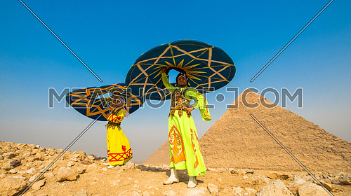 2 Egyptian sufi dancers performing at the pyramids