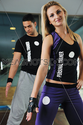 fitness personal trainer in fitness club exercise with client