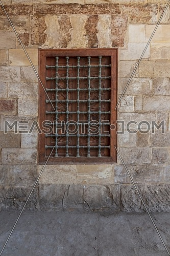 Mamluk era wooden closed window with wooden ornate grid over stone bricks wall, Mosque of Aqsunqur (Blue Mosque), Bab Al Wazeer District, Old Cairo, Egypt
