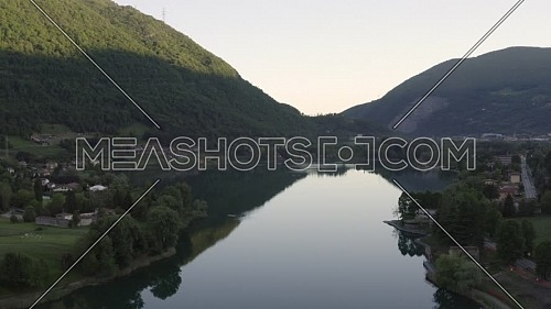 Drone flying over Lake Endine with the mountains in the background,Lombardy,Italy.