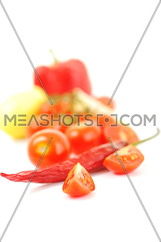 fresh lemon and tomato fruit isolated on white