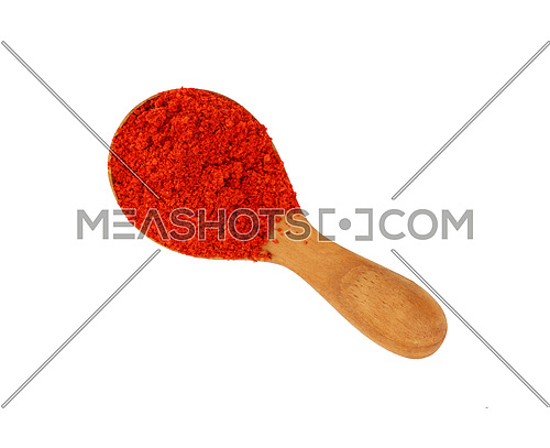 Close up one wooden scoop spoon full of red chili pepper or paprika powder isolated on white background, elevated top view, directly above