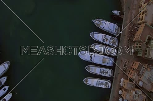 close up using Drone shot flying above Al Gouna Marina for yachts  at sunset