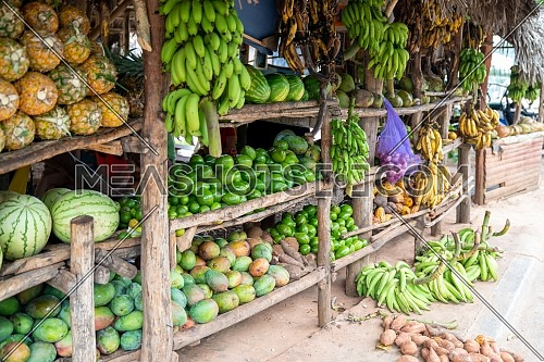 Fruits and vegetables shop on tropical marketplace on the street,Samana peninsula,Dominican republic.