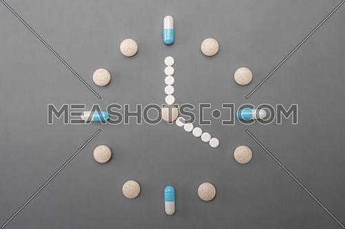 Clock formed by pills tables, conceptual image