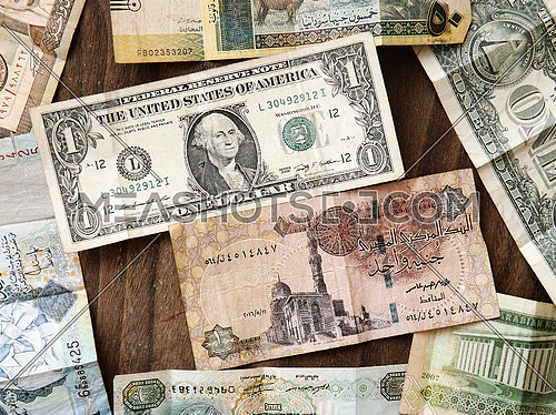 different currencies on wooden background