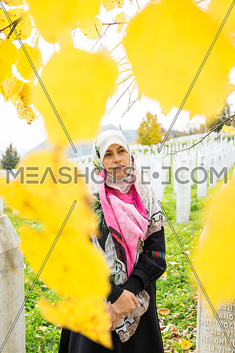 Muslim woman in nature standing alone