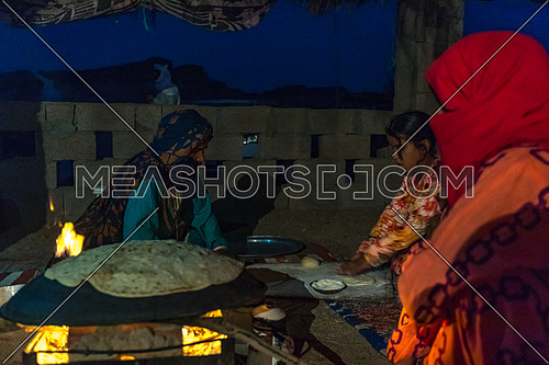 Bedouin Females cooking traditional food at a shelter in Sainai by Night