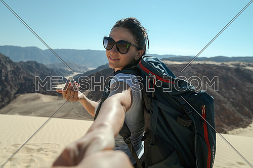 Follow me shot with female tourist in Ain Hodouda in sinai by day