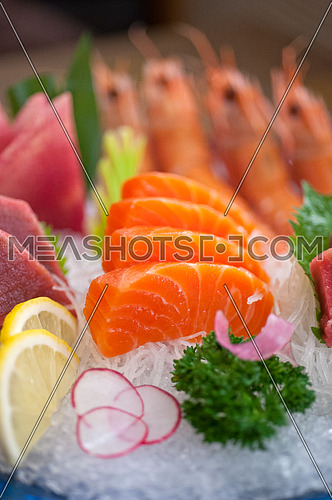 Japanese style assorted sashimi dish laid over crushed ice