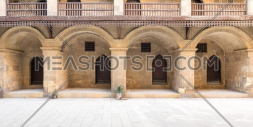 Facade of the ground floor of caravansary (Wikala) of Bazaraa showing four arches, four wooden doors and small windows, Cairo, Egypt