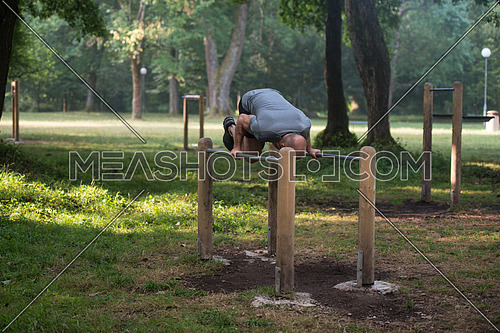 Athlete Working Out Hand Stand On Parallel Bars In An Outdoor Gym - Doing Street Workout Exercises