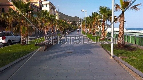 Varazze promenade at sunset with only one person walking alone
