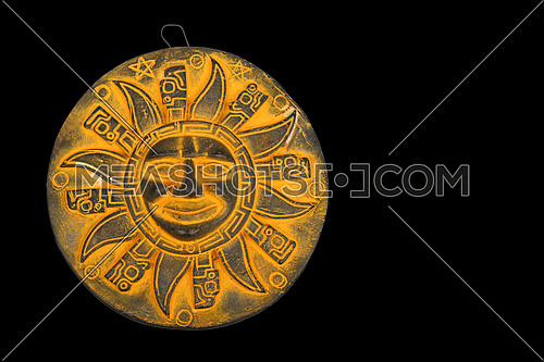 Mexican traditional yellow ceramic sun symbol plate souvenir isolated on black background