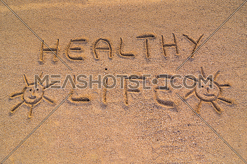 In the picture the words on the sand \
