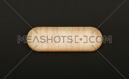 Figured ornately shaped blank wooden sign with round corners and copy space in center of black paper background, title slide template