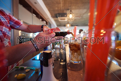 professional  barman prepare fresh coctail drink and representing nightlife and party event concept