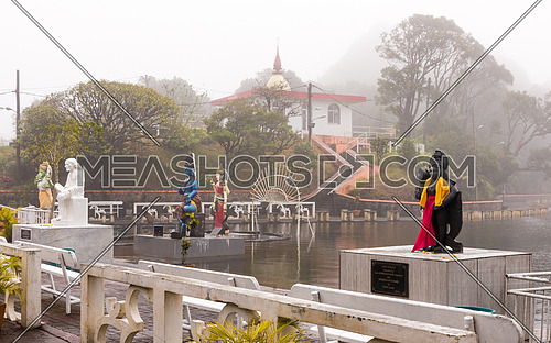 Hindu staues in a famous temple (Grand Basin), in the day with mist ,create mystical atmosphere.Mauritius