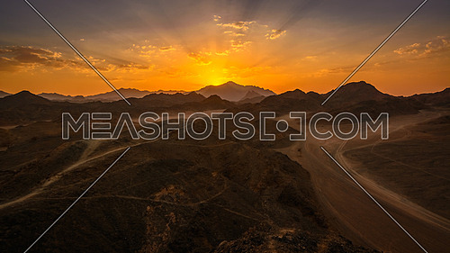 In the picture the Egyptian desert rocks at sunset.