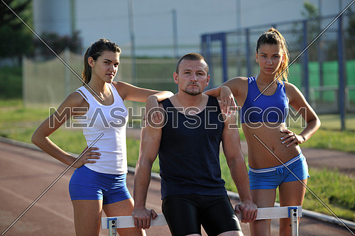 group op athletics people standing and posing at early morning on stadum with athletic race track