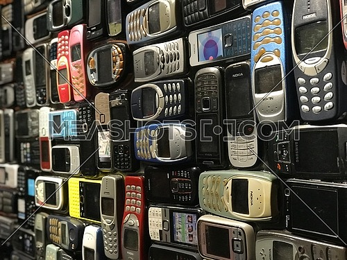 Old phones together like wall art