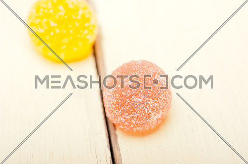 sugar jelly fruit candy over white wood table