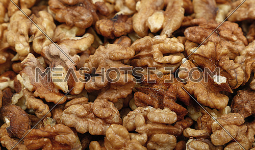 Shelled walnuts on retail market, close up, background, low angle view