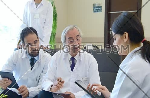 senior middle eastern doctor meeting and discussing with team