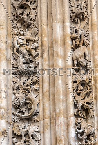 Salamanca, España: August 18, 2019: detail of figure of astronaut worked in stone in door of Branches (north), opposite to the Palace of Anaya, realized by sculptor Miguel Romero Con motivo de to receive Salamanca the exhibition The Ages of the Man in 1993
