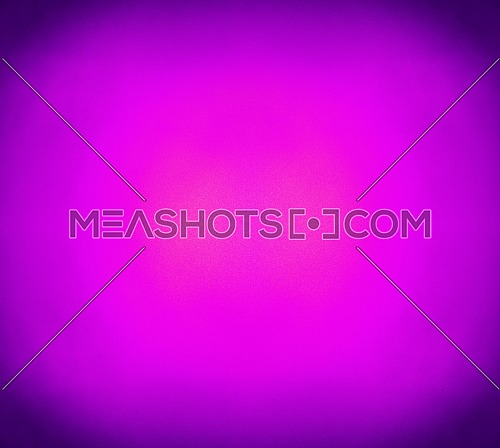 Abstract purple and violet grunge background with noise grain texture, vivid pink color gradient from center and dark shaded corners