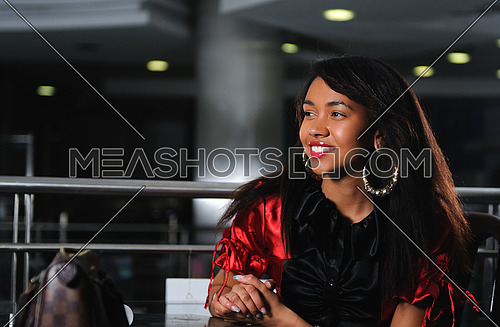 business woman in red dress smilling