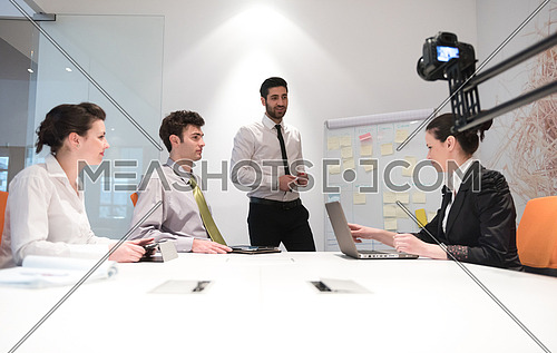 business people group brainstorming on meeting at office, businessman presenting plans, tasks, ideas and projects on white flip board