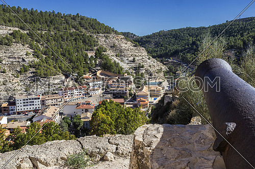 Alcala del Jucar, Spain - October 29, 2016: Panoramic view of the city, at the bottom of the bullring in the form of a boat, artillery cannon from the castle, fortress of Almohad origin, take on Alcala del Jucar, Spain