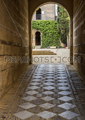 Almodovar del Rio, Cordoba, Spain - June 9, 2018: Interior access corridor atraves to dependences on the castle, It is a fortitude of Moslem origin, it was a Roman fort and the current building has definitely origin Berber, Almodovar del Rio, Spain