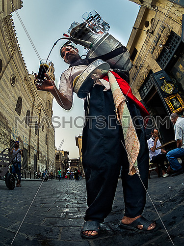 low angel for male seller of Al-Arkous in Mahrousa at day