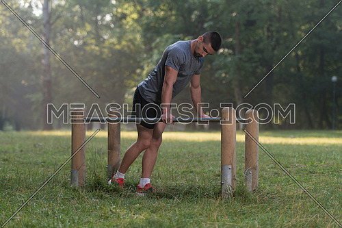 Handsome Muscular Young Man Workout In The Park